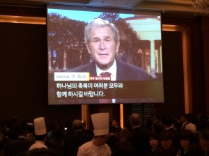 Former U.S. President George W. Bush offers words of congratulations to Dr. Kim and all those aiding this work